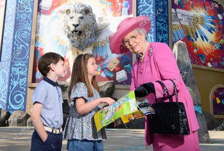 Stock Image of The Queen's look-a-like helps Prince George and Princess Charlotte get ready for an awe-inspiring adventure on the UK's first flying theatre ride, Flight of the Sky Lion at the LEGOLAND® Windsor Resort.