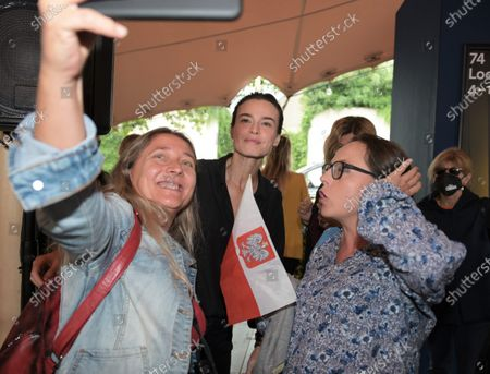 Kasia Smutniak with fans with Polish flag