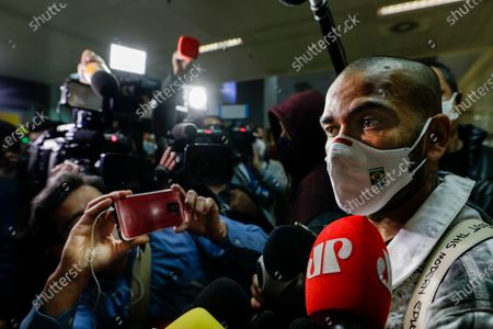 Daniel Alves, soccer player with Brazil's Olympic team that won the gold at the 2020 Tokyo Olympics, speaks to the press upon arrival to Sao Paulo International Airport in Guarulhos, Brazil