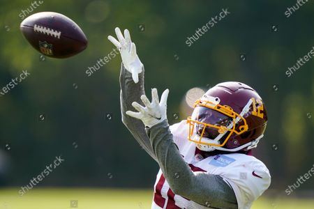Washington Football Team wide receiver Tony Brown (12) catches a pass during practice at the team's NFL football training facility, in Ashburn, Va