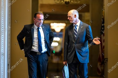 Republican Senators Mike Lee from Utah (L) and Rick Scott from Florida (R) walk to the Senate floor in the US Capitol in Washington, DC, USA, 09 August 2021. The Senate is poised to pass the one trillion US dollars bipartisan infrastructure bill by the morning of 10 August.