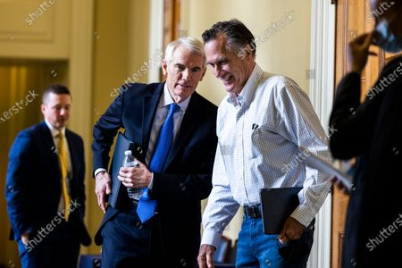 Republican Senators Rob Portman from Ohio (L) and Mitt Romney (R) leave a Republican luncheon in the US Capitol in Washington, DC, USA, 09 August 2021. The Senate is poised to pass the one trillion US dollars bipartisan infrastructure bill by the morning of 10 August.