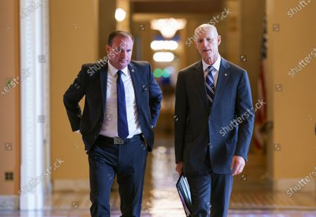 Sen. Mike Lee, R-Utah, left, and Sen. Rick Scott, R-Fla., leave a meeting in the office of Senate Minority Leader Mitch McConnell, R-Ky., as a coalition of Democrats and Republicans push the $1 trillion bipartisan infrastructure package closer to passage despite a few holdouts trying to derail one of President Joe Biden's top priorities, at the Capitol in Washington