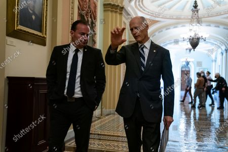 Sen. Mike Lee (R-UT) and Sen. Rick Scott (R-FL) talk in the Ohio Clock corridor after leaving the office of Senate Minority Leader Mitch McConnell (R-KY) on Capitol Hill on Monday, Aug. 9, 2021 in Washington, DC. The Senate, in final debate, prepares to vote on a $1 trillion bipartisan infrastructure bill. (Kent Nishimura / Los Angeles Times)