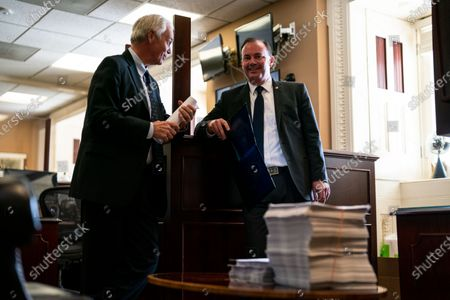 Sen. Ron Johnson (R-WI) chats with Sen. Mike Lee (R-UT) ahead of a news conference with Sen. Rick Scott (R-FL) on Capitol Hill on Monday, Aug. 9, 2021 in Washington, DC. The Senate, in final debate, prepares to vote on a $1 trillion bipartisan infrastructure bill. (Kent Nishimura / Los Angeles Times)