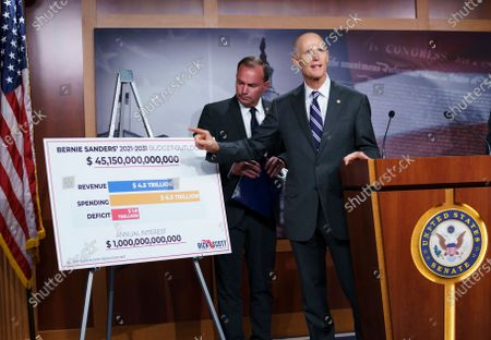 Sen. Rick Scott, R-Fla.,joined at left by Sen. Mike Lee, R-Utah, charges Sen. Bernie Sanders, I-Vt., chair of the Senate Budget Committee, with contributing to inflation, during a news conference at the Capitol in Washington