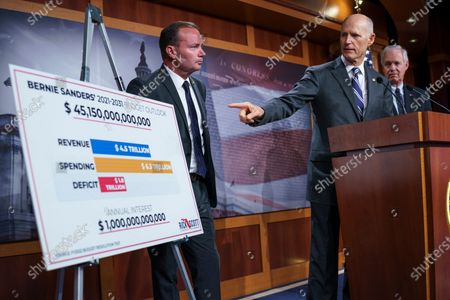 From left, Sen. Mike Lee, R-Utah, Sen. Rick Scott, R-Fla., and Sen. Ron Johnson, R-Wis., charge Sen. Bernie Sanders, I-Vt., chair of the Senate Budget Committee, with contributing to inflation, during a news conference at the Capitol in Washington