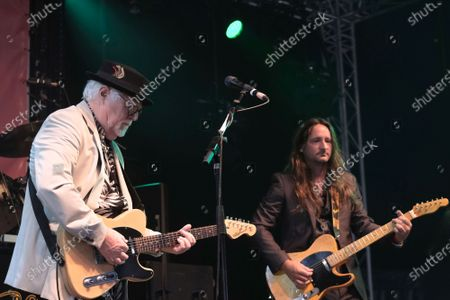 James Cregan, producer, English rock guitarist and bassist, former lyricist with Rod Stewart, and band member with Steve Harley and the Cockney Rebel, performs live on stage with Ben Mill and the band Cregan & Co at Wickham Festival.
