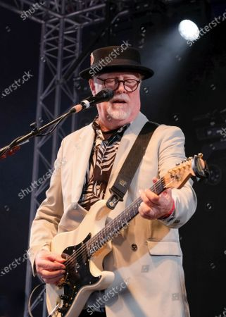 Stock Image of James Cregan, producer, English rock guitarist and bassist, former lyricist with Rod Stewart, and band member with Steve Harley and the Cockney Rebel, performs live on stage with the band Cregan & Co at Wickham Festival.