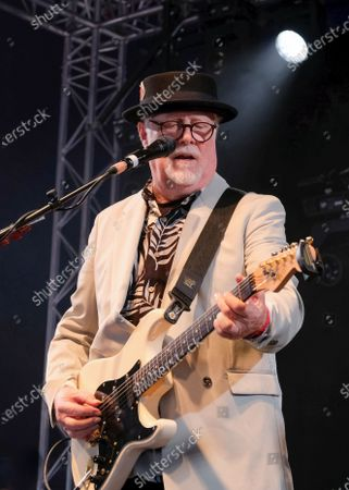 James Cregan, producer, English rock guitarist and bassist, former lyricist with Rod Stewart, and band member with Steve Harley and the Cockney Rebel, performs live on stage with the band Cregan & Co at Wickham Festival.