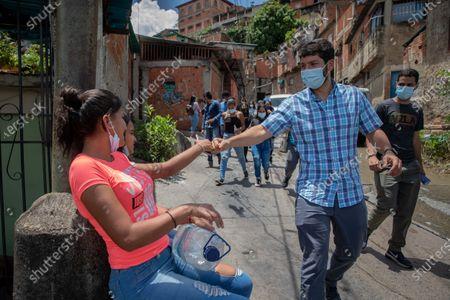 Editorial photo of Venezuelan politician Roberto Patino greets the inhabitants of the 'El 70' neighborhood of El Valle, Caracas, Venezuela - 10 Aug 2021