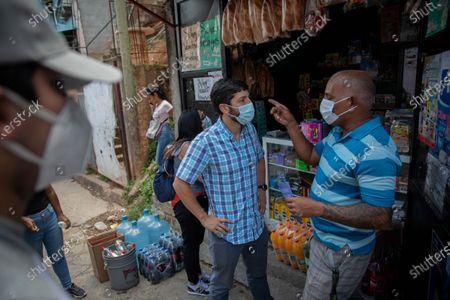 Editorial picture of Venezuelan politician Roberto Patino greets the inhabitants of the 'El 70' neighborhood of El Valle, Caracas, Venezuela - 10 Aug 2021