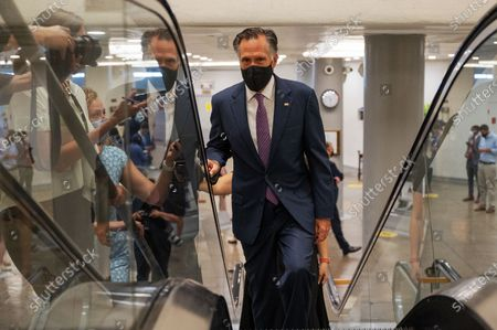 U.S. Senator Mitt Romney (R-UT) speaks with reporters inside the U.S. Capitol in Washington, DC, on August 10, 2021