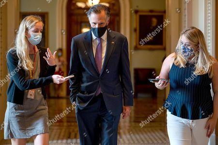 U.S. Senator Mitt Romney (R-UT) speaks with reporters inside the U.S. Capitol