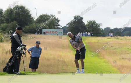 Mark Foster former Olympic and World Championship swimmer putts during the Cazoo Classic Pro Am