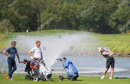 Stock Picture of Lee Dixon in action on the fairway with Anton Du Beke and Teddy Sheringham during the Cazoo Classic Pro am