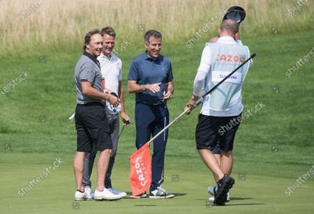 Lee Dixon Teddy Sheringham and Anton Du Beke with Andy Sullivan on the 18th green