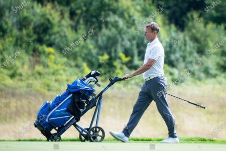 Teddy Sheringham walks the course at The London Club