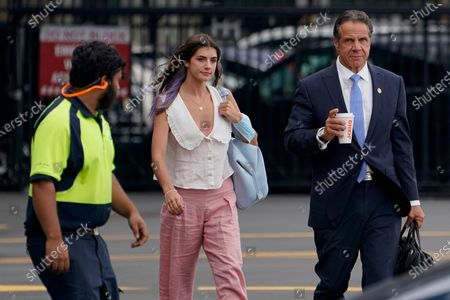 New York Gov. Andrew Cuomo, right, prepares to board a helicopter with his daughter Michaela Cuomo after announcing his resignation, in New York. Cuomo says he will resign over a barrage of sexual harassment allegations. The three-term Democratic governor's decision, which will take effect in two weeks, was announced Tuesday as momentum built in the Legislature to remove him by impeachment