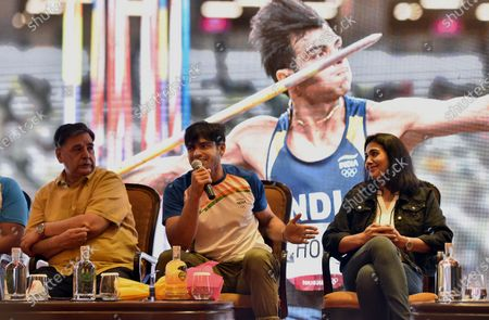 Neeraj Chopra, who won the gold medal in the javelin throw event of the recently concluded Tokyo Olympics 2020, with former athlete Anju Bobby George during a press conference   on August 10, 2021 in New Delhi, India.