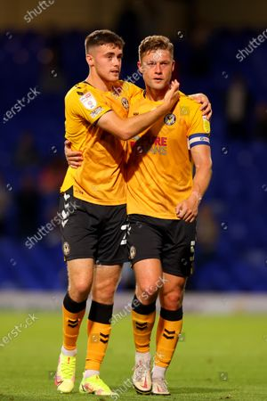 Lewis Collins and James Clarke of Newport County celebrate the 0-1 win