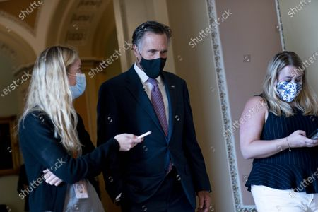 Sen. Mitt Romney, R-Utah, speaks to a reporter as the Senate moves from passage of the infrastructure bill to focus on a massive $3.5 trillion budget resolution, a blueprint of President Joe Biden's top domestic policy ambitions, at the Capitol in Washington