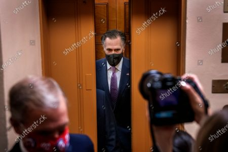 United States Senator Mitt Romney (Republican of Utah) talks with reporters as he makes his way through the Senate subway during a vote at the US Capitol in Washington, DC,. The Senate is expected to vote today on final passage of the bipartisan $1 trillion H.R. 3684, Infrastructure Investment and Jobs Act. the