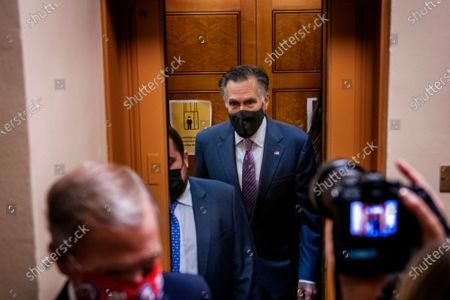 Stock Image of United States Senator Mitt Romney (Republican of Utah) talks with reporters as he makes his way through the Senate subway during a vote at the US Capitol in Washington, DC,. The Senate is expected to vote today on final passage of the bipartisan $1 trillion H.R. 3684, Infrastructure Investment and Jobs Act. the