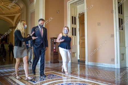Stock Photo of Sen. Mitt Romney, R-UT, speaks to reporters after voting on infrastructure bill amendments at the US Capitol in Washington, DC., on Tuesday, August 10, 2021.