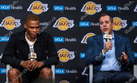 Russell Westbrook, left, listens to Lakers head coach Frank Vogel speak during an introduction press conference at the Staples Center in Los Angeles Tuesday, Aug. 10, 2021. He was also introduced by Vice President of Basketball Operations/General Manager Rob Pelinka, not pictured. (Allen J. Schaben / Los Angeles Times)