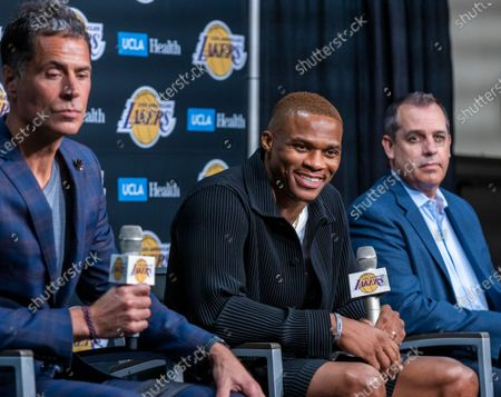 Russell Westbrook, center, speaks after being introduced to the media as one of the newest Lakers by vice president of basketball operations/general manager Rob Pelinka, left, and head coach Frank Vogel during a press conference at the Staples Center in Los Angeles Tuesday, Aug. 10, 2021. (Allen J. Schaben / Los Angeles Times)