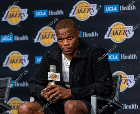 Russell Westbrook speaks after being introduced to the media as one of the newest Lakers by vice president of basketball operations/general manager Rob Pelinka and head coach Frank Vogel during a press conference at the Staples Center in Los Angeles Tuesday, Aug. 10, 2021. (Allen J. Schaben / Los Angeles Times)