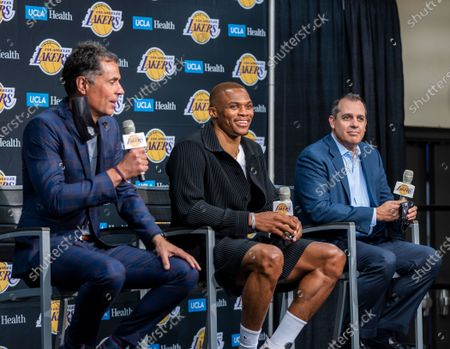 Russell Westbrook, center, and head coach Frank Vogel, right, listen to Lakers vice president of basketball operations/general manager Rob Pelinka speak as he introduces Westbrook at one of the newest Lakers during a press conference at the Staples Center in Los Angeles Tuesday, Aug. 10, 2021. (Allen J. Schaben / Los Angeles Times)