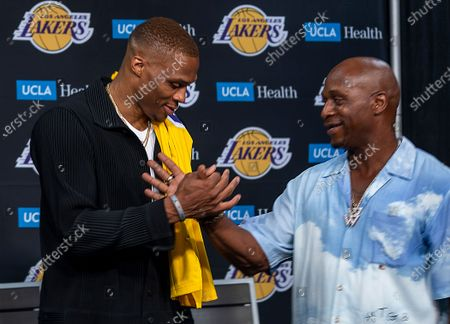 Russell Westbrook is greeted by his dad, Russell Westbrook, after receiving with his new Lakers jersey and being introduced to the media as one of the newest Lakers by vice president of basketball operations/general manager Rob Pelinka and head coach Frank Vogel during a press conference at the Staples Center in Los Angeles Tuesday, Aug. 10, 2021. (Allen J. Schaben / Los Angeles Times)