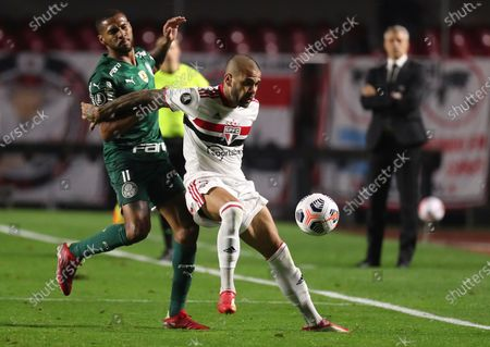 Daniel Alves of Brazil's Sao Paulo, right, and Wesley of Brazil's Palmeiras battle for the ball during a Copa Libertadores soccer match at Morumbi stadium in Sao Paulo, Brazil, Tuesday, Aug.10, 2021