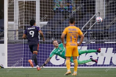 Seattle Sounders forward Raul Ruidiaz (9) scores a goal past UANL Tigres goalkeeper Miguel Ortega as Tigres' Leonardo Fernandez (17) watches during the first half of a Leagues Cup soccer match, in Seattle