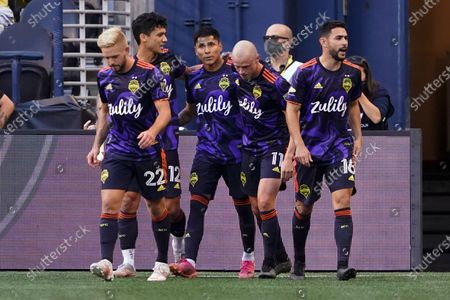 Seattle Sounders forward Raul Ruidiaz, third from left, is congratulated by teammates after he scored a goal against UANL Tigres during the first half of a Leagues Cup soccer match, in Seattle