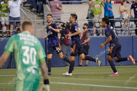 Seattle Sounders midfielder Nicolas Lodeiro, center, celebrates with teammates Alex Roldan (16) and Raul Ruidiaz, right, after Lodeiro scored a goal against UANL Tigres goalkeeper Miguel Ortega (30), during the second half of a Leagues Cup soccer match, in Seattle