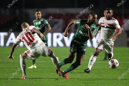 Daniel Alves (L) of Sao Paulo in action against Wesley (R) of Palmeiras during the Copa Libertadores quarter finals soccer match between Sao Paulo and Palmeiras at Morumbi stadium in Sao Paulo, Brazil, 10 August 2021.