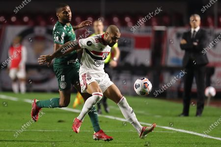 Daniel Alves (R) of Sao Paulo in action against Wesley (L) of Palmeiras during the Copa Libertadores quarter finals soccer match between Sao Paulo and Palmeiras at Morumbi stadium in Sao Paulo, Brazil, 10 August 2021.