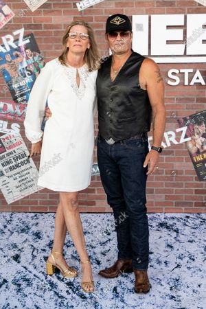 Chris Bauer (R) poses with his wife Laura (L) on the red carpet prior to the premiere of the Starz television series 'Heels' in Los Angeles, California, USA, 10 August 2021. The wrestling drama will premiere worldwide on 15 August 2021.