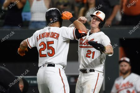 Baltimore Orioles' Anthony Santander, left, is congratulated by Austin Hayes, after hitting a two run home run on which Hayes score against the Detroit Tigers during the eighth inning of a baseball game, in Baltimore. The Tigers won 5-3