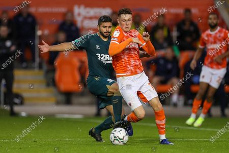 Middlesbrough midfielder Sam Morsy (5) makes a challenge on Blackpool Midfielder Sonny Carey (16) aduring the EFL Cup match between Blackpool and Middlesbrough at Bloomfield Road, Blackpool
