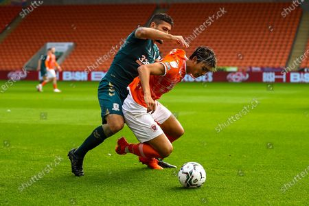 Middlesbrough midfielder Sam Morsy (5) tackles Blackpool Midfielder Kenny Dougall (12) during the EFL Cup match between Blackpool and Middlesbrough at Bloomfield Road, Blackpool