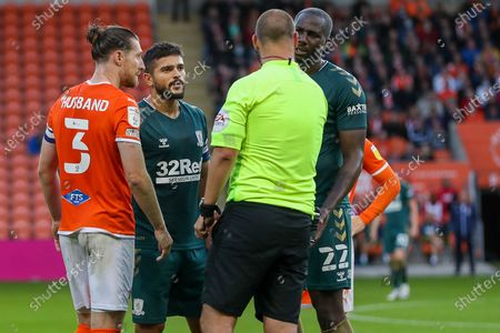 The Referee Robert Madley has a word with Middlesbrough midfielder Sam Morsy (5) and Blackpool Defender James Husband (3) during the EFL Cup match between Blackpool and Middlesbrough at Bloomfield Road, Blackpool