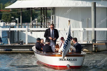 Olympian rower Sir Matthew Pinsent CBE (standing). The sun was shining today as guests and rowers were back at Henley Royal Regatta for the first time since the Covid-19 Pandemic began