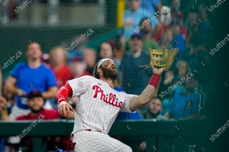 Philadelphia Phillies right fielder Bryce Harper catches a pop foul put by Los Angeles Dodgers' Chris Taylor during the fifth inning of a baseball game, in Philadelphia