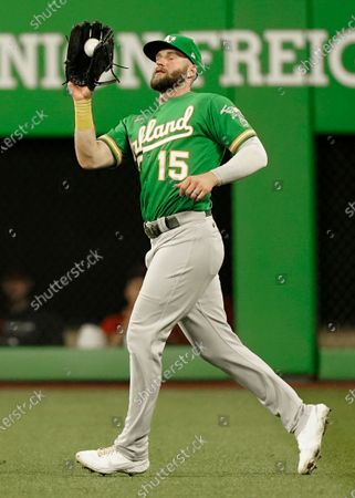 Oakland Athletics' Seth Brown catches a fly ball hit by Cleveland Indians' Andres Gimenez in the second inning of a baseball game, in Cleveland. Gimenez was out on the play