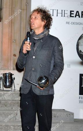 Yves Behar presenting one of the awards.