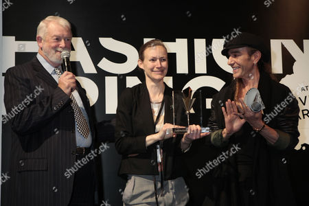 Designer Corrie Nielsen receiving her award for her collection at Fashion Fringe from Colin McDowell (left) and judge John Galliano